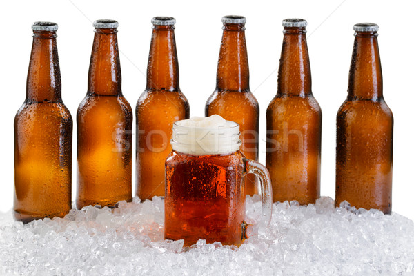 Glass of beer with six pack of ice cold bottles isolated on whit Stock photo © tab62