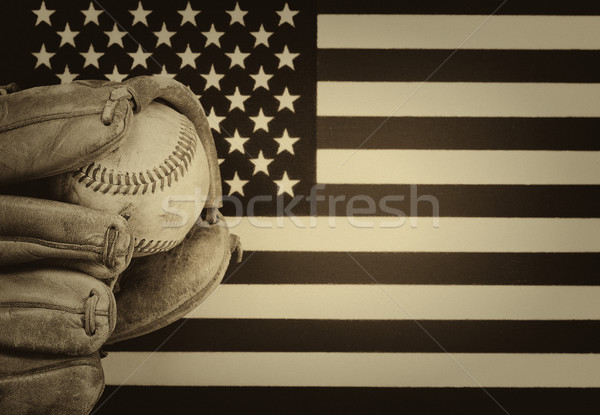 Worn baseball glove and used ball on American Flag  Stock photo © tab62