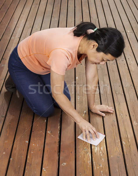 Matue woman sanding deck by hand  Stock photo © tab62
