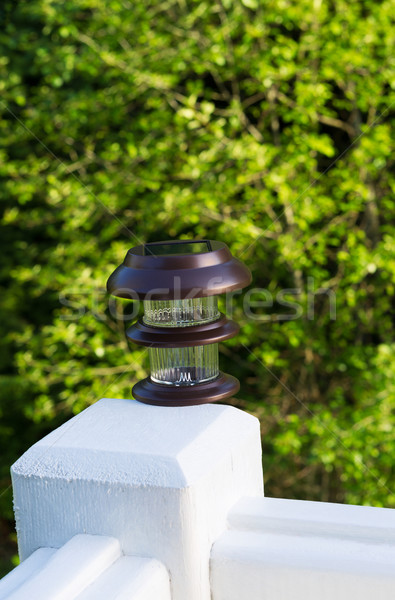 New solar lamp mounted on deck post outdoors  Stock photo © tab62