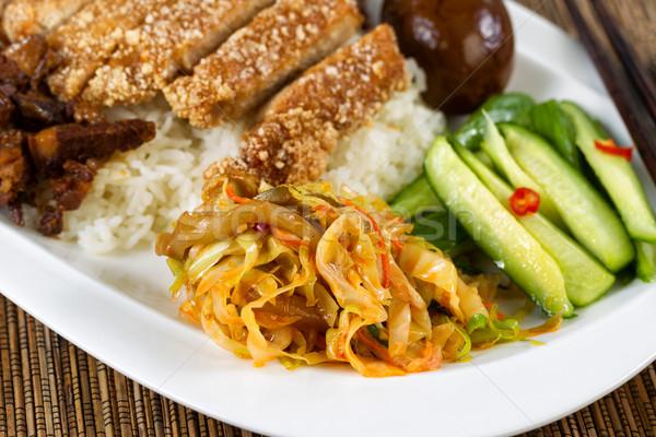 Fried bread coated pork slice dish in white dish Stock photo © tab62