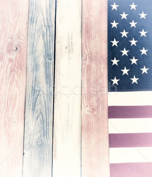 Border of vintage USA flag on faded painted wooden boards in nat Stock photo © tab62