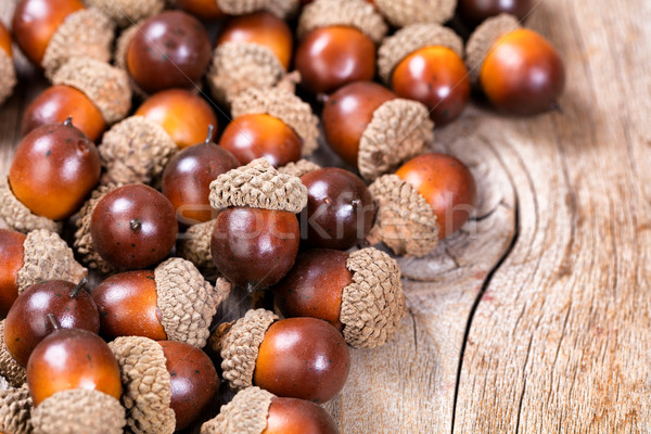 Pile of acorn decorations on rustic wood Stock photo © tab62