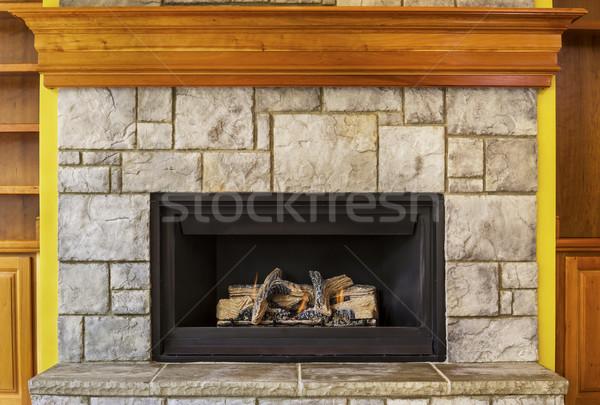 Földgáz kandalló kő fa tűz építkezés Stock fotó © tab62