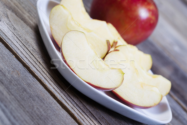 Angled View of Apple Slices on White Plate  Stock photo © tab62