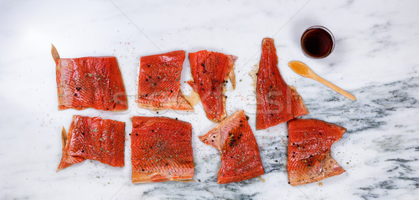 Raw salmon fillets prepared for smoke cooking on marble stone co Stock photo © tab62