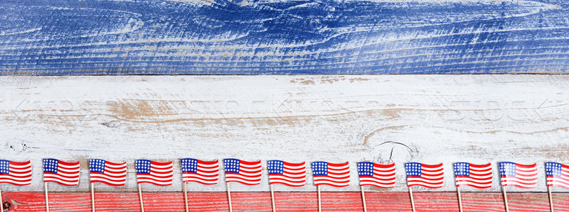 Small USA flags on bottom of rustic boards with national colors  Stock photo © tab62
