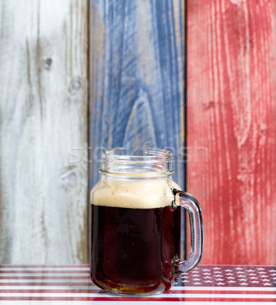 Single beer with faded wooden boards painted in USA national col Stock photo © tab62