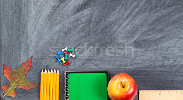 Chalkboard with school supplies and autumn leaf Stock photo © tab62