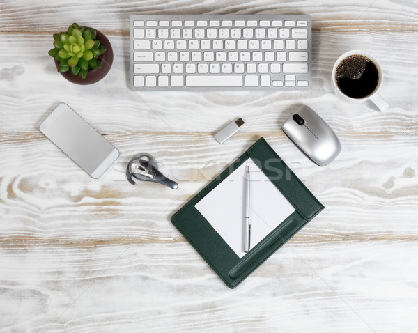 Stock photo: Overhead view of modern technology devices on white wooden board