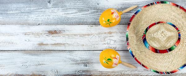 Sombrero with maracas for Cinco de Mayo on weathered white woode Stock photo © tab62