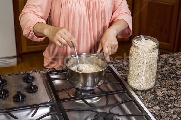 Stirring Oatmeal for Breakfast  Stock photo © tab62