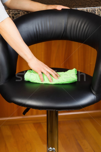 Cleaning Leather Kitchen Chair with microfiber rag  Stock photo © tab62