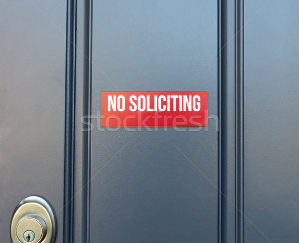No soliciting red sign on residential front door of home Stock photo © tab62