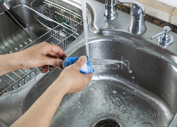 Female hands washing single small knife in kitchen sink Stock photo © tab62