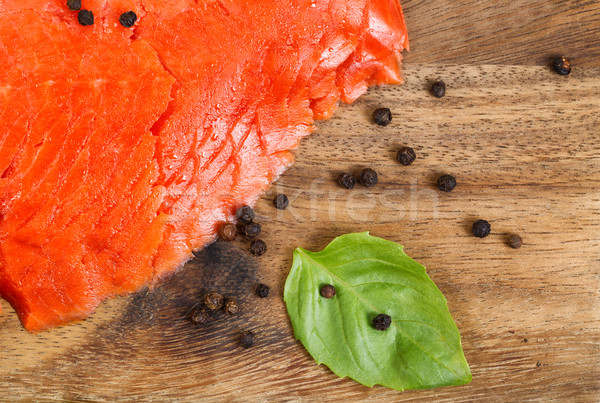 Cold Smoked Red Salmon on Server board with spices and herb  Stock photo © tab62