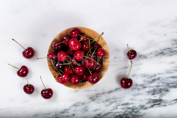 Fresh bowl of sweet red cherries on marble stone countertop  Stock photo © tab62