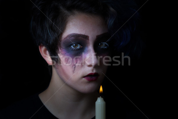 Girl in scary makeup with lite candle on black background Stock photo © tab62