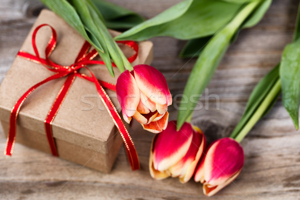 Tulips on top of boxed gift Stock photo © tab62