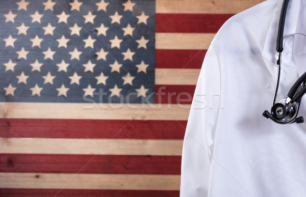 Close up of medical doctor jacket and stethoscope with rustic US Stock photo © tab62