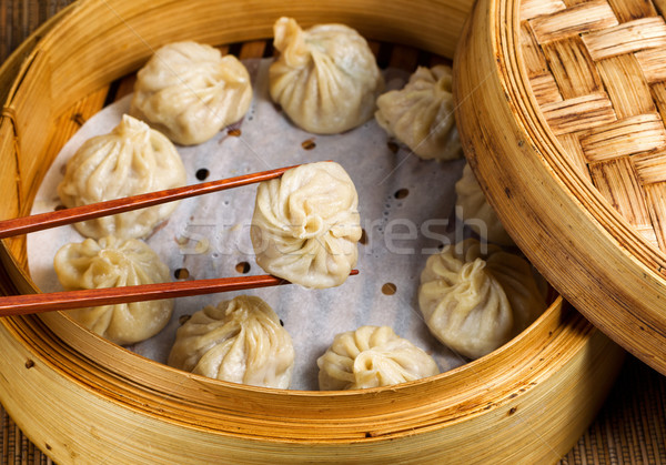 Freshly steamed Chinese dumplings out of bamboo steamer ready to Stock photo © tab62