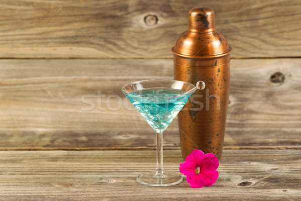 Mixed drink and Single Flower on Weathered Wood  Stock photo © tab62