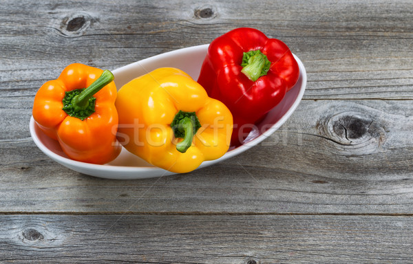 Fresh Bell Peppers in white bowl on rustic wood Stock photo © tab62