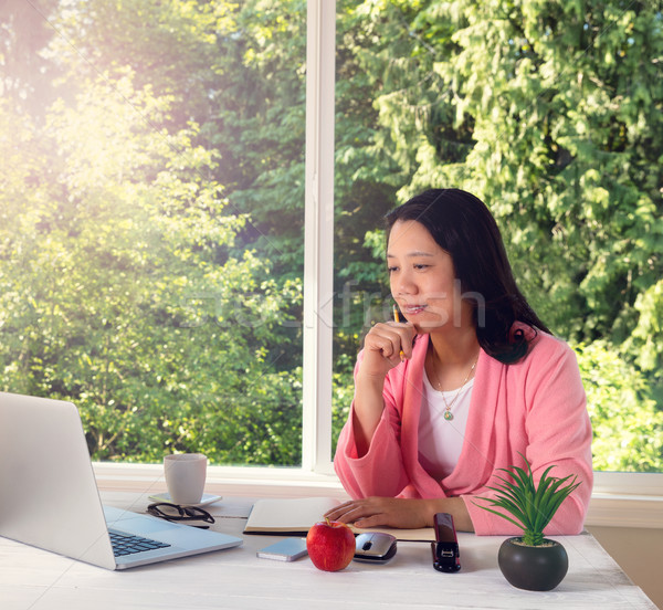 Mature woman enjoying morning light while working from home  Stock photo © tab62