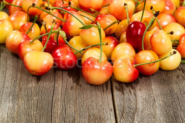 Ripe Rainier cherries on aged wooded table Stock photo © tab62