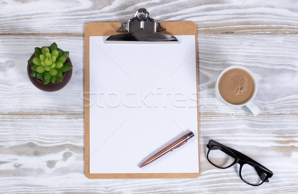 White desktop with blank clipboard and paper plus coffee  Stock photo © tab62
