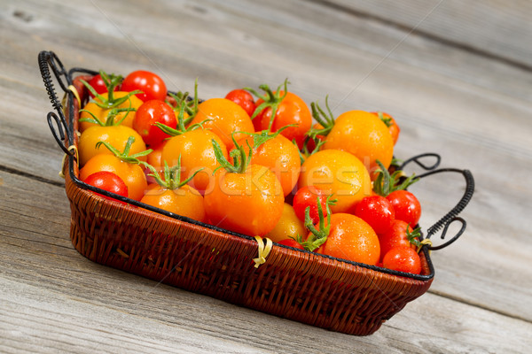 Angled View of Garden Fresh Tomatoes in basket  Stock photo © tab62