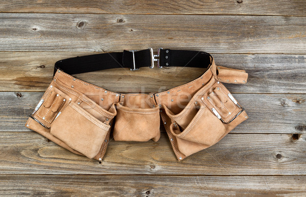 Leather tool belt on rustic wooden boards  Stock photo © tab62