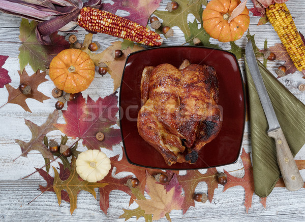 Thanksgiving turkey with autumn decorations on rustic table sett Stock photo © tab62