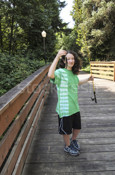 Young girl with Small Fish on Wooden Bridge  Stock photo © tab62