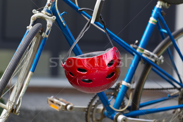 Bright red bicycle helmet hanging from handle bars   Stock photo © tab62