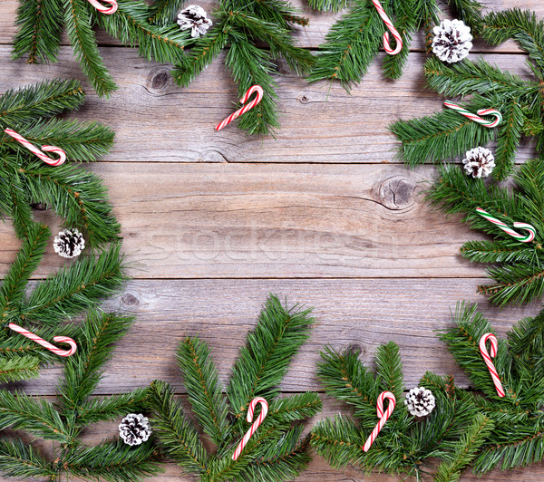 Fir branches and candy canes forming circle on rustic wooden boa Stock photo © tab62