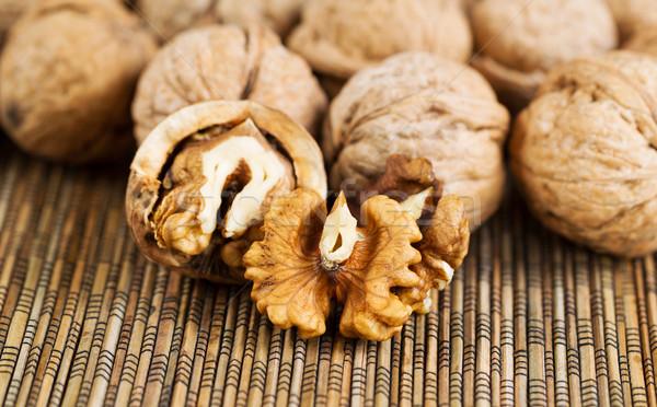 Fresh Walnuts on Bamboo Mat  Stock photo © tab62