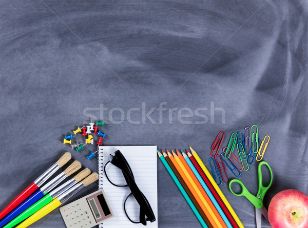 Back to school basic supplies placed on bottom part of erased bl Stock photo © tab62
