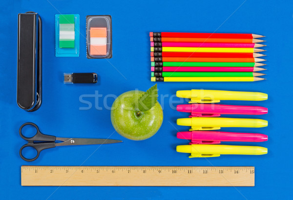 Basic supplies for office or back to school on blue background Stock photo © tab62