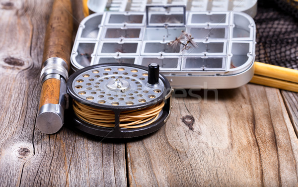 Vintage fly fishing reel and gear on rustic wooden background  Stock photo © tab62