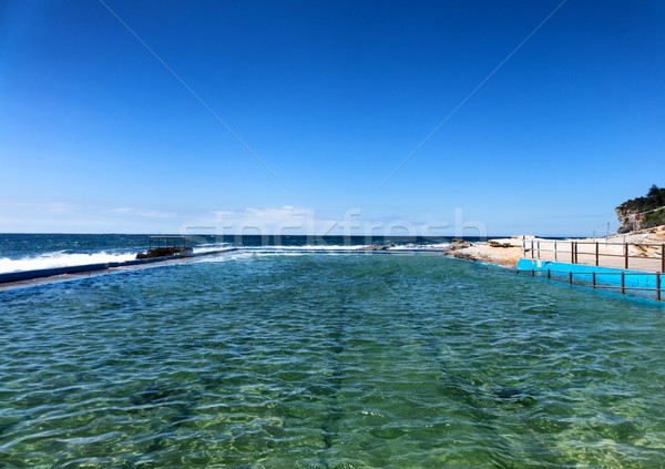 Rock swimming pool flowing into the Pacific Ocean Stock photo © tab62