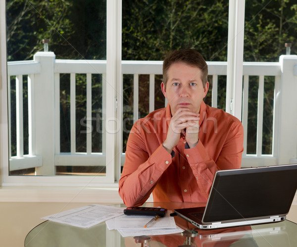 Mature man in Thought while working from home  Stock photo © tab62