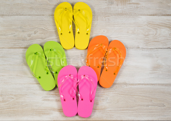 New Sandals Placed on Faded Wood Stock photo © tab62