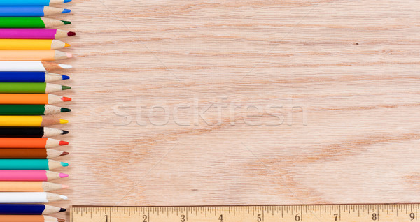 Colorful pencils lined up along with ruler on oak wooden desktop Stock photo © tab62