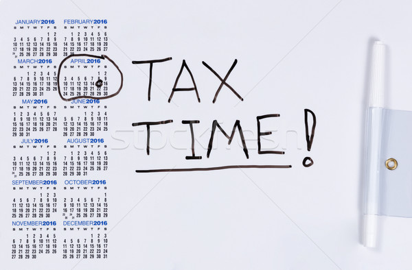 White board with calendar marked for tax reminder in April  Stock photo © tab62