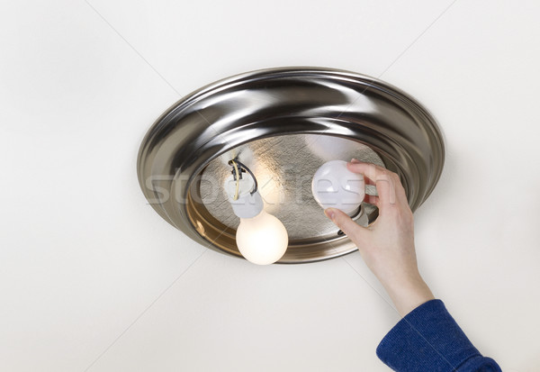 Stock photo: Removing bad light bulb