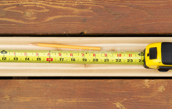 Measuring New Boards for Outdoor Deck  Stock photo © tab62