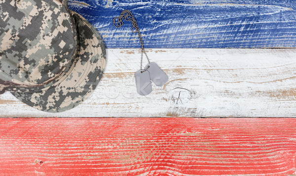 USA national colors with military cap and ID tags on wooden plan Stock photo © tab62