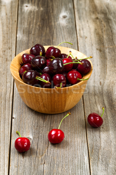 Whole cherries in bowl on rustic wood ready to eat Stock photo © tab62