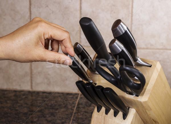 Kiválaszt kés kéz ki tele szett Stock fotó © tab62